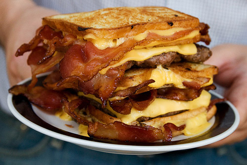 Called the Double Bacon Hamburger Fatty Melt, this is three bacon-stuffed grilled cheese sandwiches stuffed with two 4oz. of beef patties.