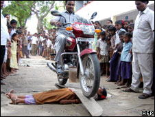 Another stunt involved the bike being ridden over a plank laid on top of a girl lying on the ground.